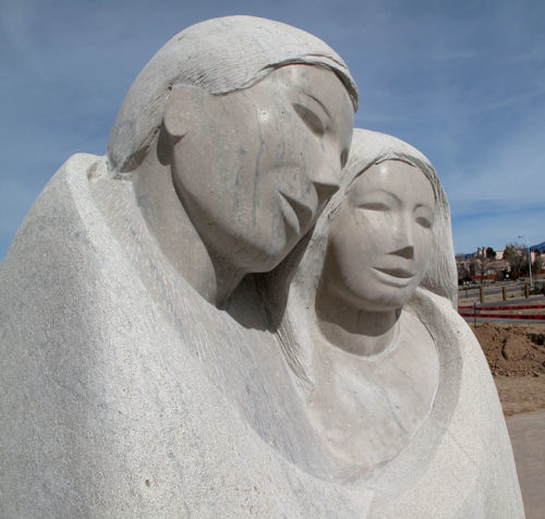 The tall couple represents early settlers to Santa Fe
